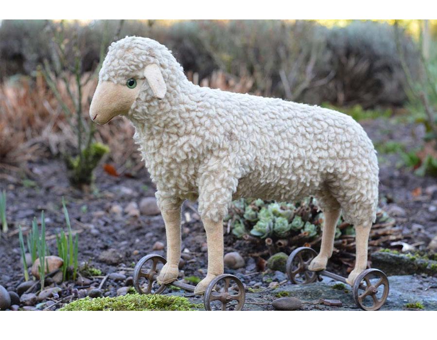 A Steiff Wool Plush Lamb On Wheels-antique animal creations