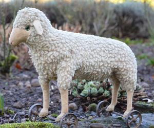 A Steiff Wool Plush Lamb On Wheels naive animal creations